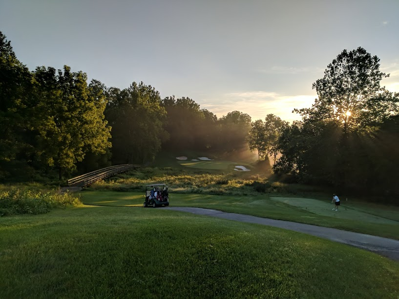 3rd hole at Greystone. A long par 3 to clear a hazard and land on a severely sloped green.  The morning mist, combined with the sun coming up made for interesting light conditions.